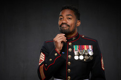 David Burnell in United States Marine Corps uniform and medals with a beard and mustache in at a gre
