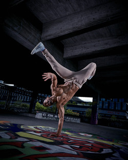 David Burnell doing a one hand stand at the abandoned railroad station in Munich Germany
