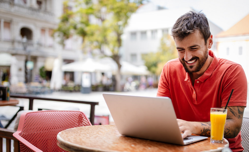 handsome-young-man-with-laptop-enjoying-