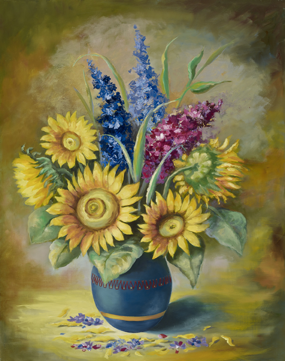Yellow sunflowers in a blue vase
