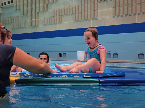 Little girl is having fun during her swimming lesson with Aquanat