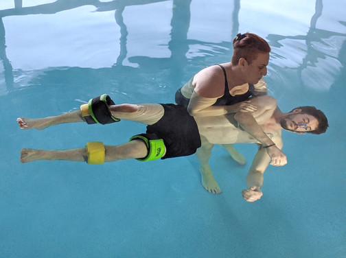 Practitioner Anat Juran is practicing Waterdance in an underwater aquatic bodywork therapy session for young man