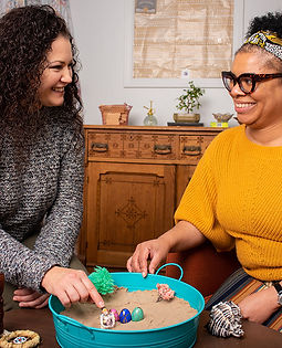 Women using sand tray therapy