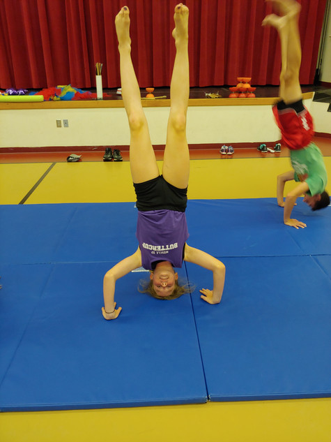 Camper doing headstand