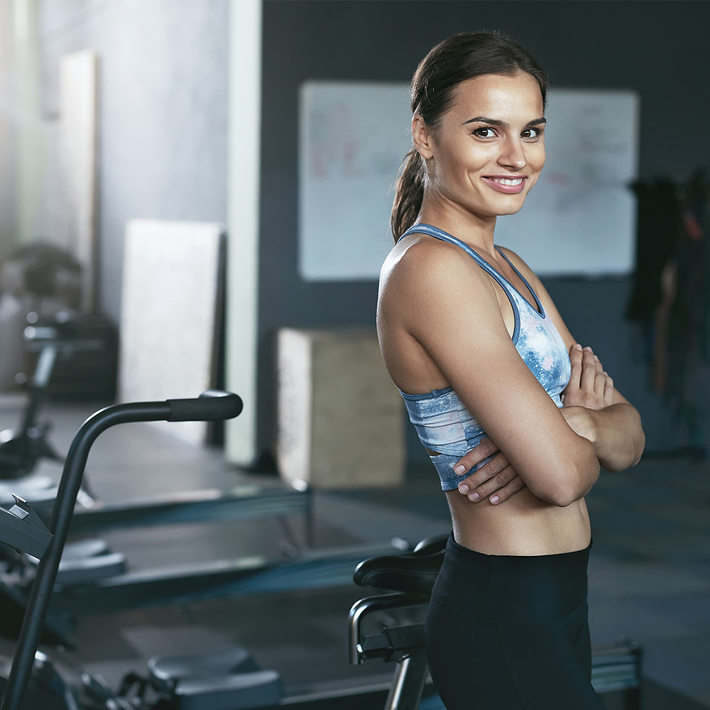 A woman in sportswear at the gym.