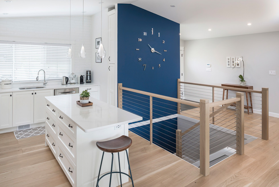 Wall Clock on Blue Wall Modern Home - Interiors Photography