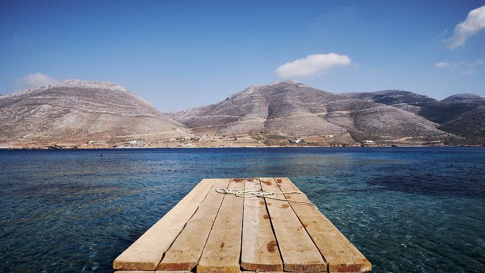 beautiful-view-nikouria-with-wooden-dock-mountains-amorgos-island.jpg