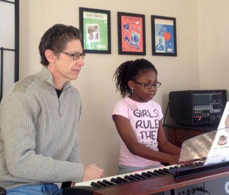 Allan-Licht-giving-piano-lessons-to-Arma