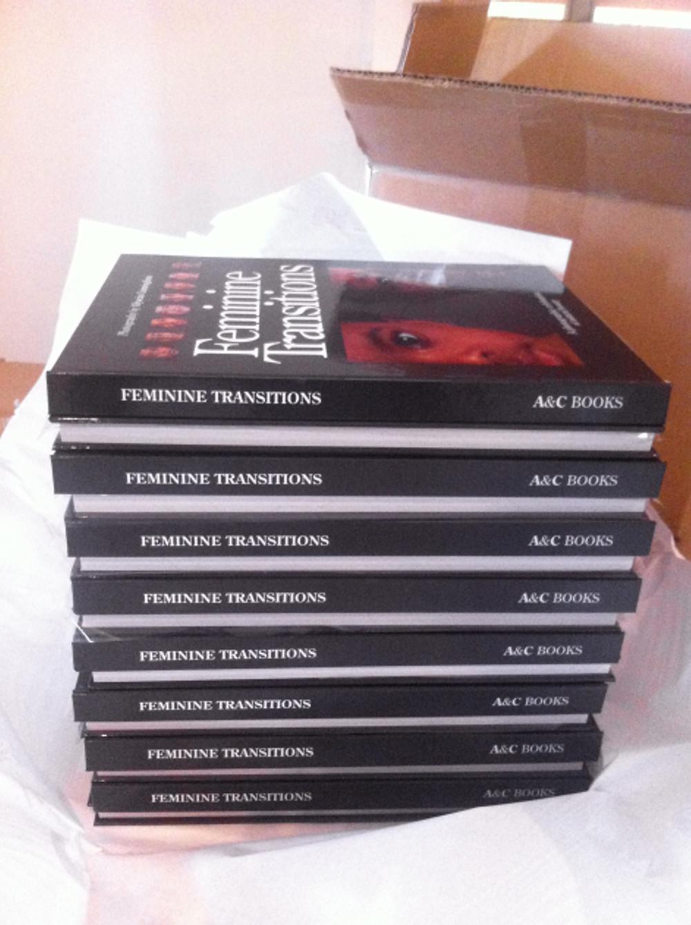 Feminine Transitions books and shipment box