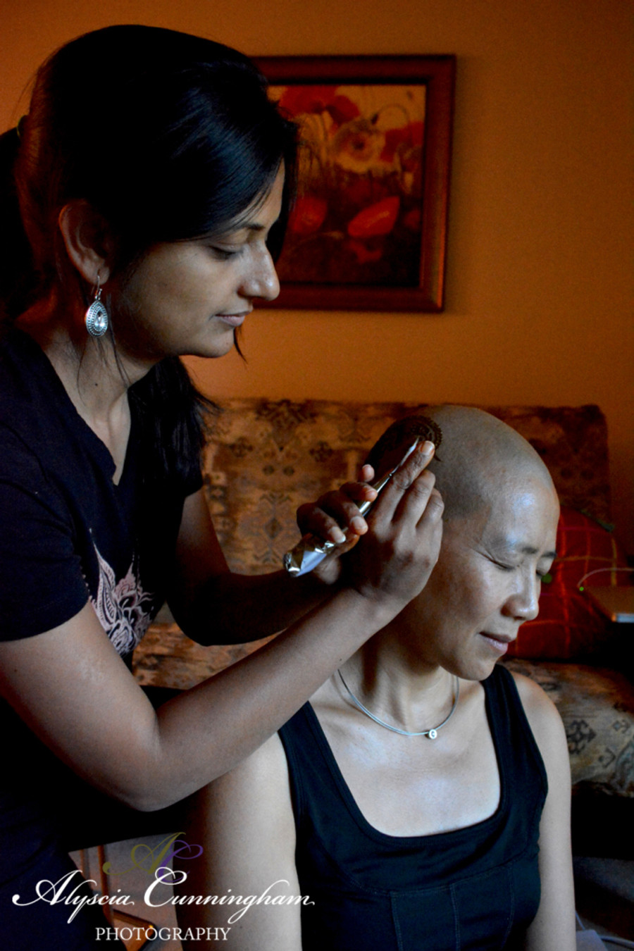Serene getting a henna crown by henna artist Deepti Khona, founder of Henna Harmony DC Metro. Serene did not loose her hair but instead shaved it in support of her friend who was diagnosed with breast cancer. That's a true friend.