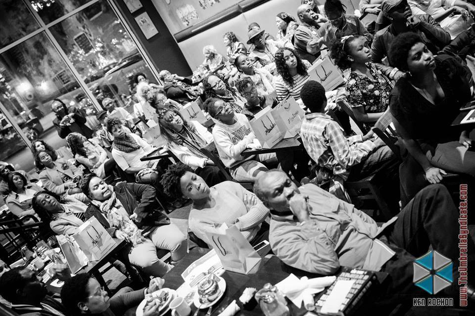 Audience for Alyscia Cunningham's book release of Feminine Transitions. Took place at busboys and poets.