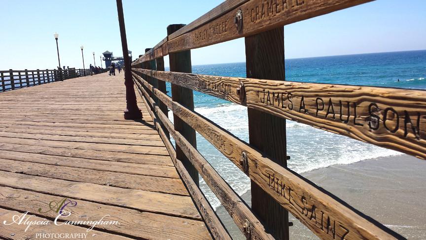 Alyscia takes photos on the Oceanside Pier in Oceanside, CA