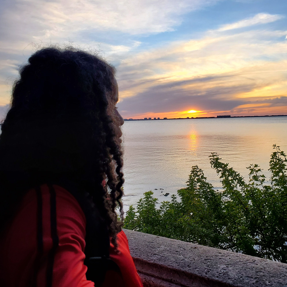 Image of Alyscia Cunningham with the sunset in the background.