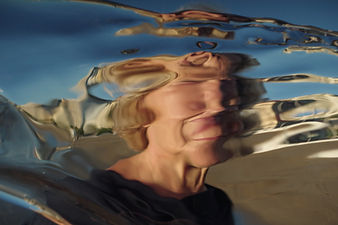 Mother, woman, distortion, reflectin, water, refraction, movement, light, sky