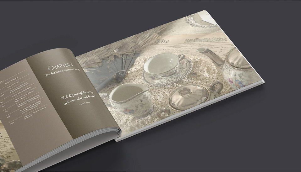 "Image of a spread of the commemoriative book ""A Barbadian Odyssey"" celebrating 100 years for Cave Shepherd"