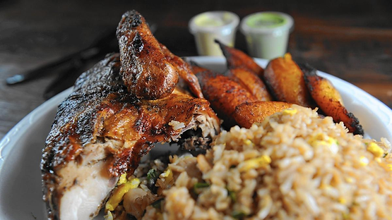 Quarter White Chicken Meal served with fried rice and fried plantains.