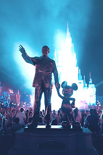 Walt Disney and Mickey Mouse statue during daytime_edited.jpg