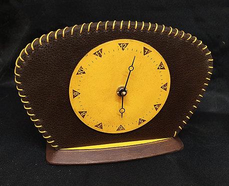 Brown and yellow mantel clock