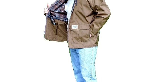 Brown nylon brair proof coat with hold has numerous pockets.