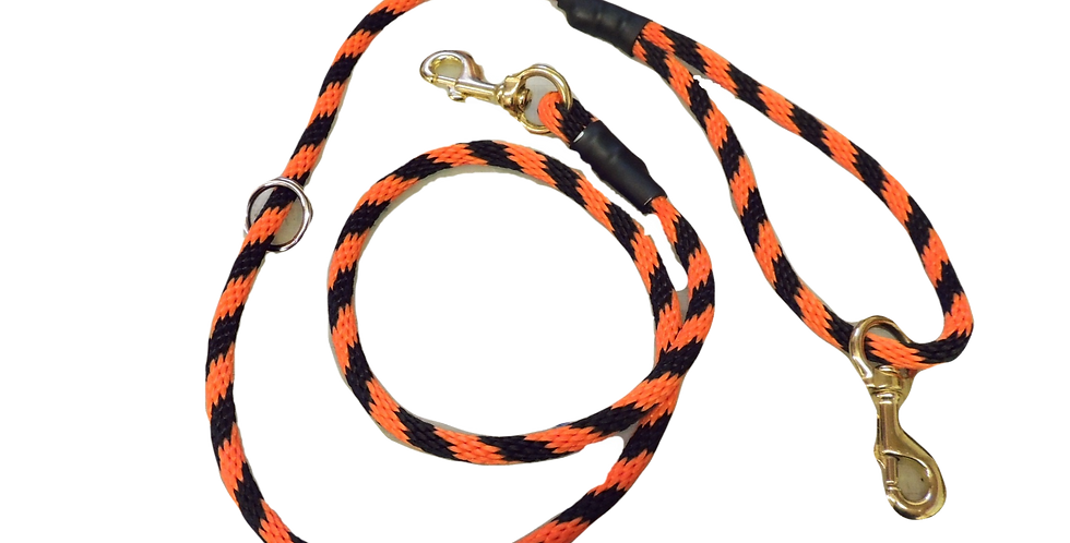 orange and black braided rope dog lead. With solid brass snaps on each end