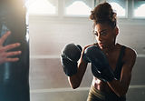 Canva - African Woman Boxing with Punchi