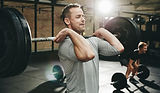 Canva - Fit Man Doing Weight Training at
