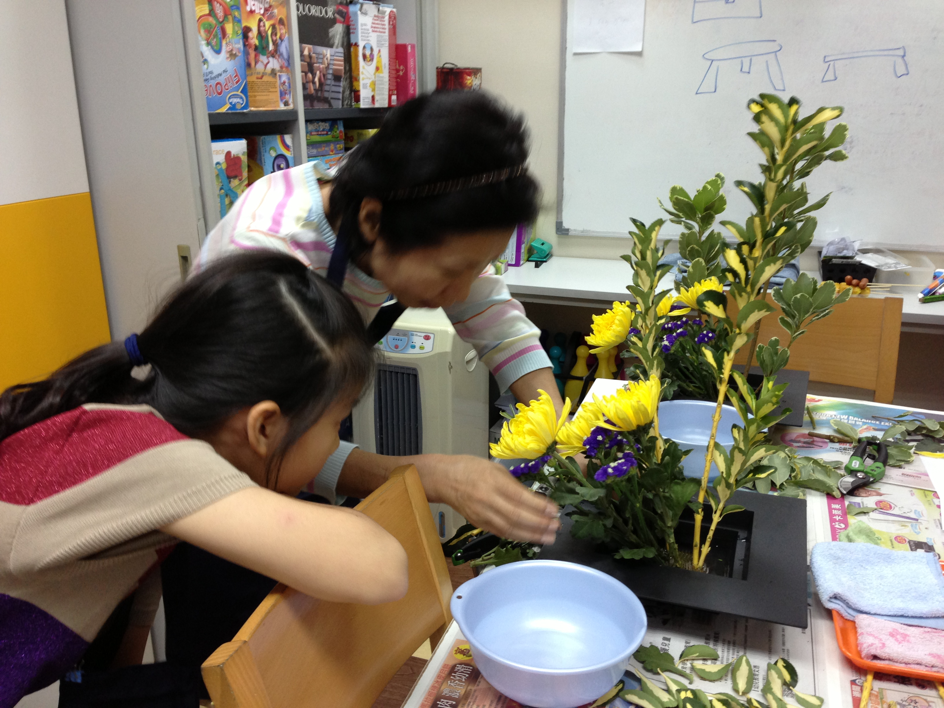 Ms Ando demonstrating to a student
