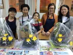 Ms Ando and students with their work