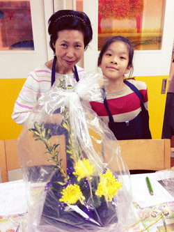Ms Ando and a student with her work