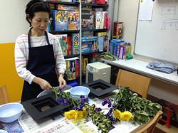 Ms Ando preparing the materials