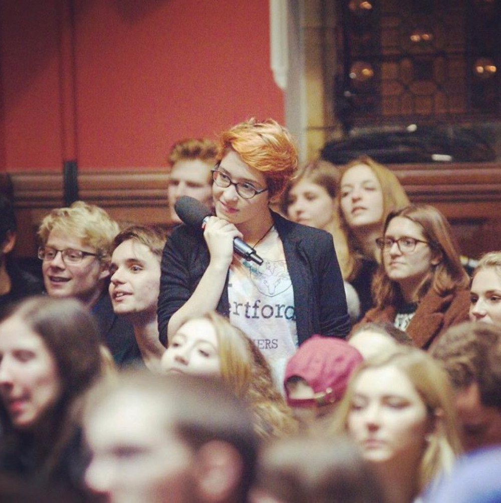 Jasmine is standing up in the audience of Hozier's Oxford Union talk, microphone in hand, swooning hard.