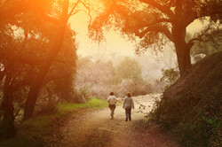 Two women walking outdoor in scenic park