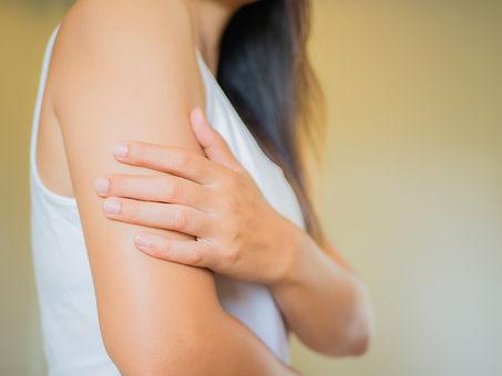 Closeup female's arm. Arm pain and injur