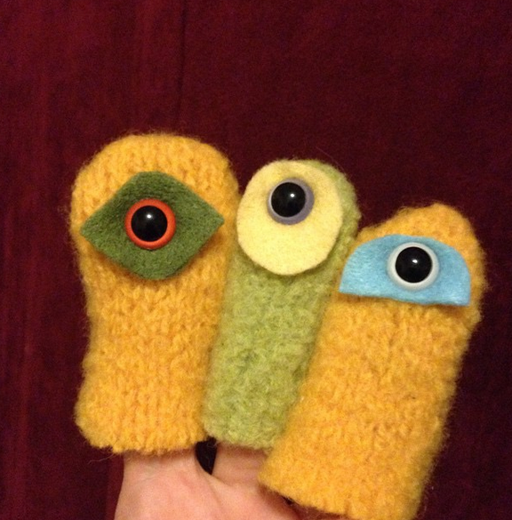 "Handcrafted wool ""cyclops"" puppets"