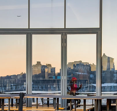B. Lorraine Smith reflected in a Lower Manhattan window during an early morning run. (Photo by Christophe Foss)