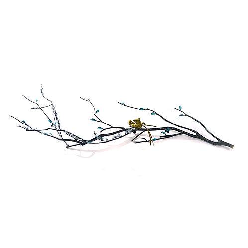 Gold birds on branch wall sculpture