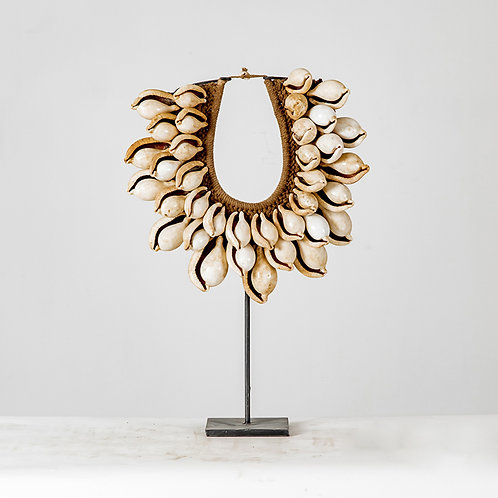 Knitted shell necklace on stand #9