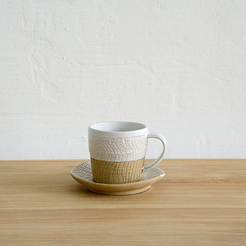 Ceramic coffee cup with saucer