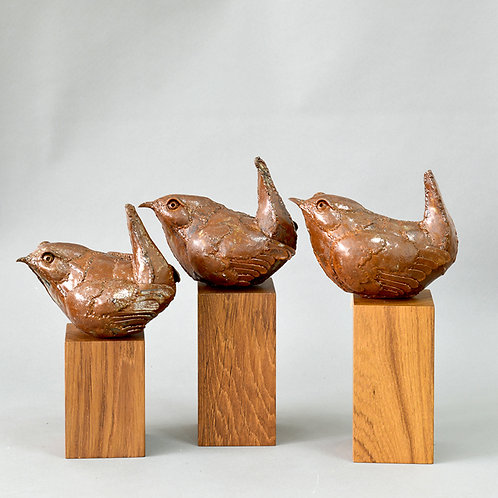 Bronze brid on wooden stand