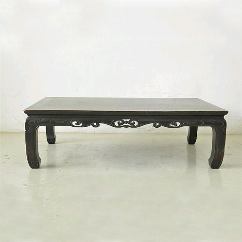 Dark wooden coffee table with carving