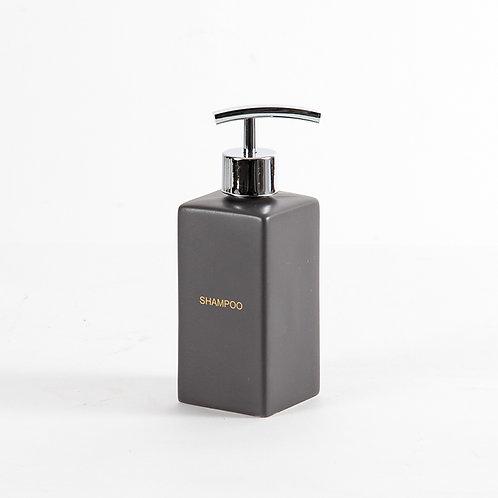 Graphite shampoo dispenser in matte black with gold wordings
