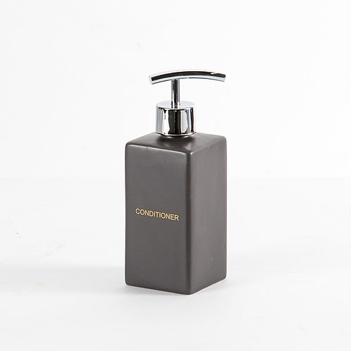 Graphite conditioner dispenser in matte black with gold wordings