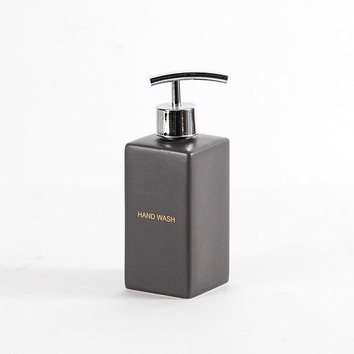 Graphite hand wash dispenser in matte black with gold wordings