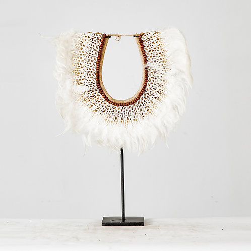 Knitted shell on stand #2, w/ white feather
