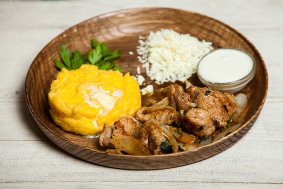 Tasty polenta with meat. Traditional Rom