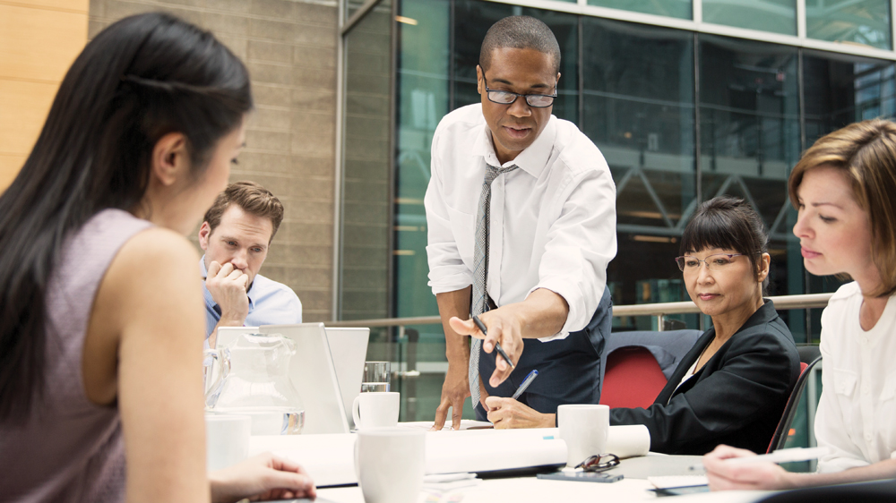 HD-Businessman-Conducting-Meeting-Pointi