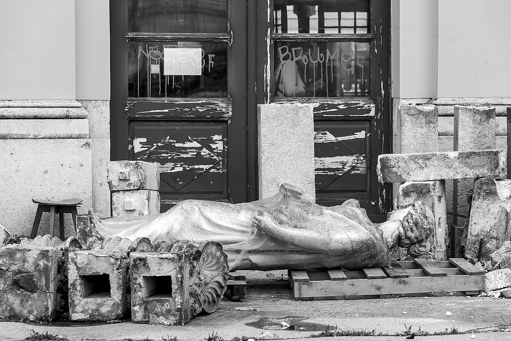 A statue lies broken at the doors of the Zagreb Railway Station.