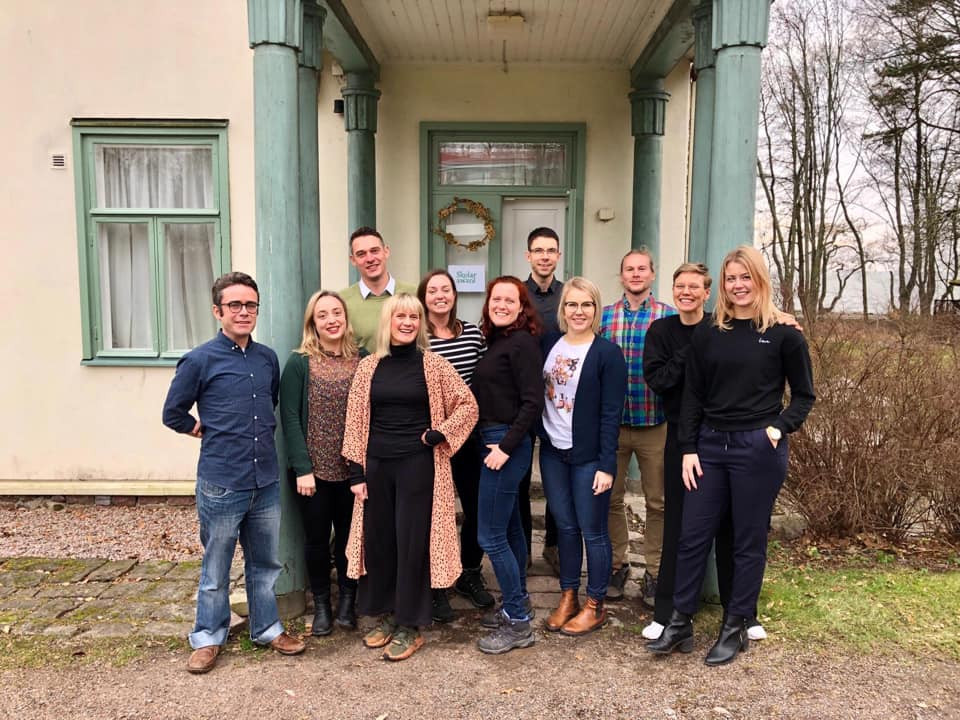 Skolar team and finalists in from of the bootcamp house in Villa Salin, Finland