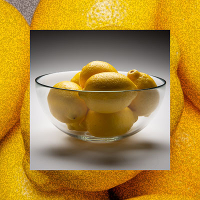 Photo of lemons in glass bowl inset on close-up of lemons.
