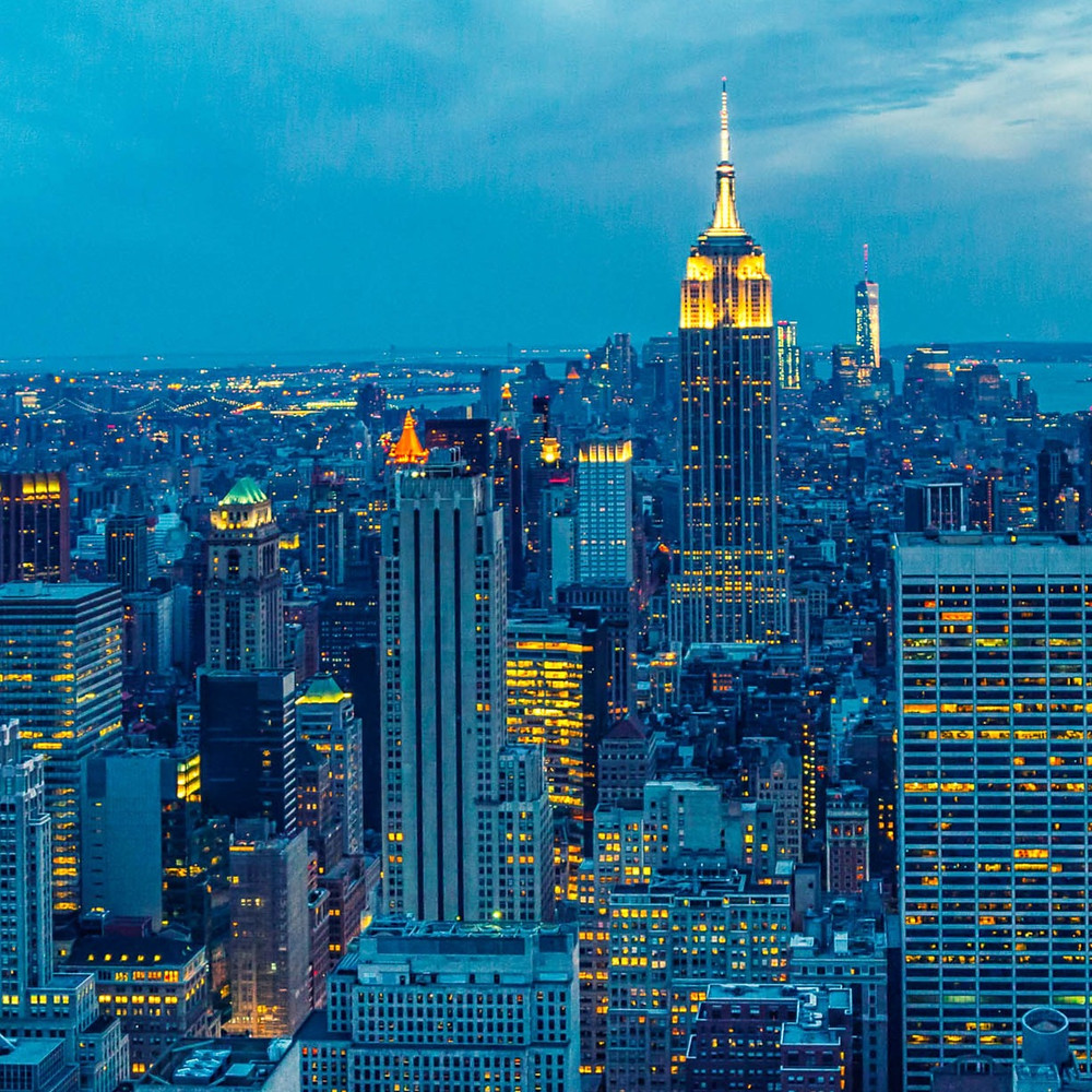 NYC skyline at dusk with view of Empire State Building.